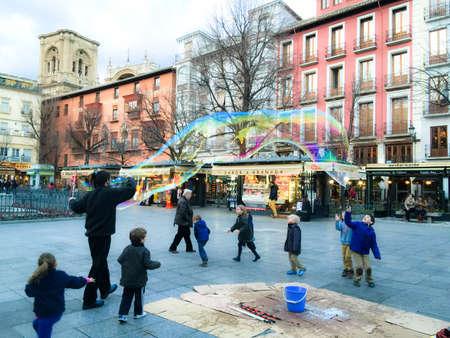 square: Children playing in Bib-Rambla square