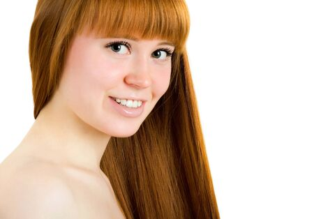 Beautiful young red-haired woman with long beauty straight hair. Isolated on white