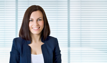 Smiling business woman. Isolated over jalousie photo