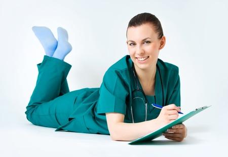 Smiling medical female doctor photo