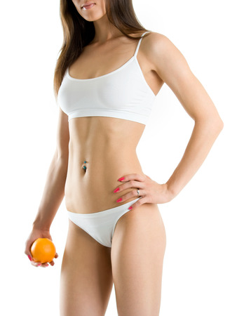 with orange and white body: Young woman body and hand holding orange isolated on white background