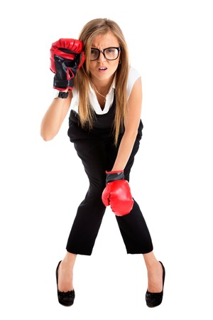 defeated: Defeated loser woman - business concept with businesswoman wearing boxing gloves standing in full body looking hopeless.