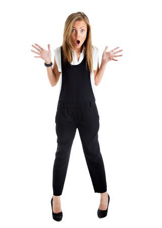 cuerpo entero: Aislado Mujer dada. Empresaria con expresión de sorpresa divertida. Joven mujer de negocios en toda su longitud mirando a la cámara en la vista de ángulo alto. Foto de archivo