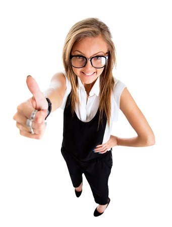 Success woman isolated giving thumbs up sign. Funny businesswoman in high and wide angle view.