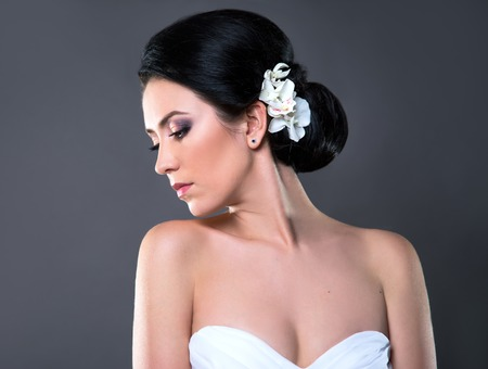 beautiful bride wearing white wedding dress with flowers on her head