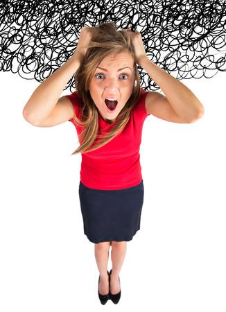 Stress. Zakenvrouw gefrustreerd en benadrukt haar haren trekken. Grappig beeld van jonge Kaukasische zaken Stockfoto