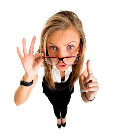 fish eye lens: Funny businessl girl pointing up fish eye lens portrait. Stock Photo