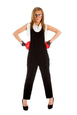 defeated: Defeated loser woman business concept with businesswoman wearing boxing gloves standing in full body looking hopeless. Stock Photo