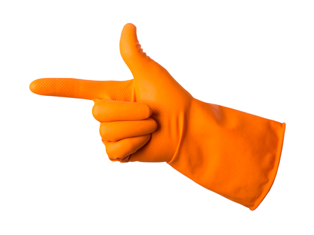 Orange gloves for cleaning on mens arm show the index finger in the direction, isolated over white Stock Photo