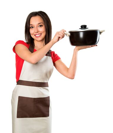 aprons: Beautiful brunette woman housewife holding pan. Studio shot over white background. Stock Photo