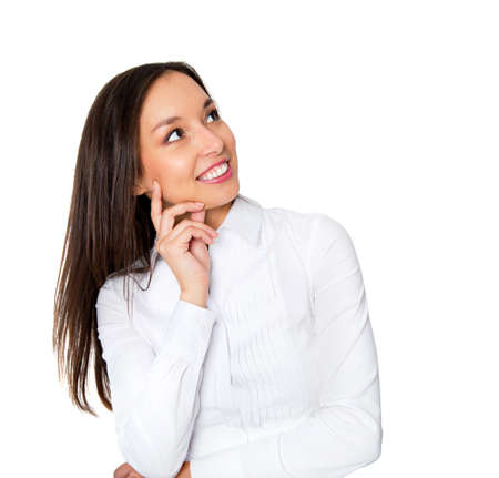 Smiling businesswoman in formalwear sitting at workplace Stock Photo