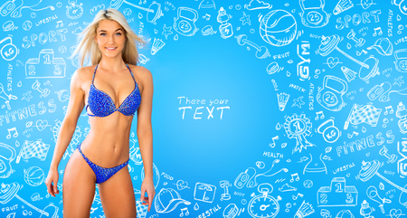 Pretty tanned woman in bikini isolated on blue and draw background