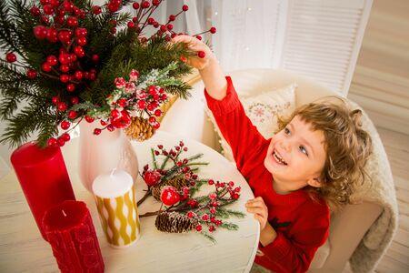 Christmas miracle, magic gift box and a child baby boy