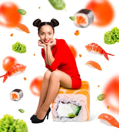 Young beautiful woman sitting on sushi, isolated on white