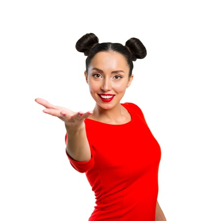 Young beautiful woman throws something, isolated on white