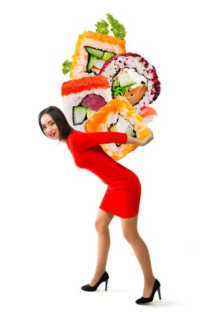 Young beautiful woman carries sushi on a white background Stock Photo