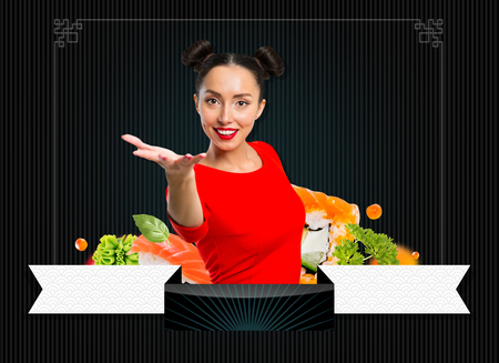 Young woman holding sushi, isolated on black
