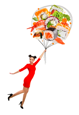 Young woman holding sushi, isolated on white Reklamní fotografie