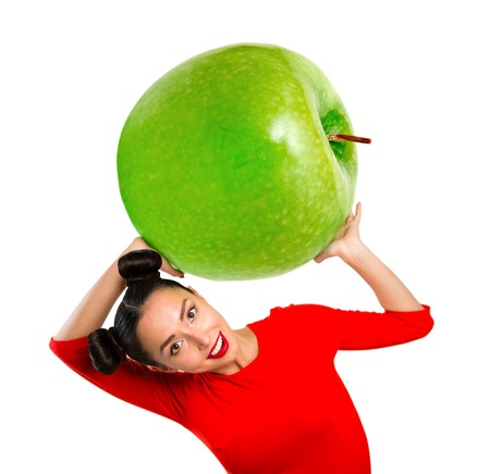 Young beautiful woman holding apple, isolated on white Stock Photo