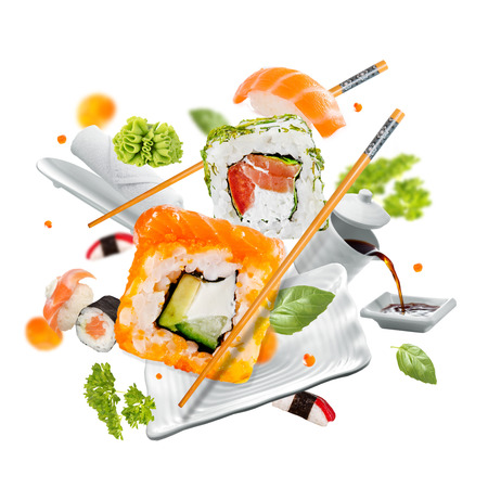 Delicious pieces of sushi, isolated on white background Imagens