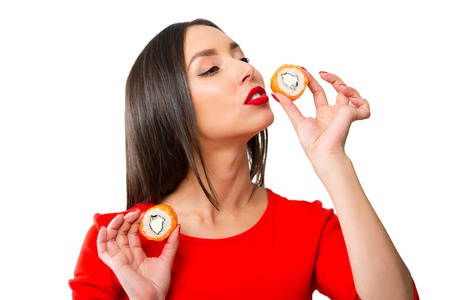 Young woman holding sushi, isolated on white Stock Photo