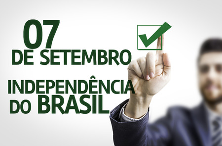 independency: Business man pointing to transparent board with text: 07 September, Brazil Independency (In Portuguese)
