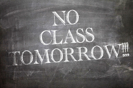 tomorrow: No Class Tomorrow written on blackboard