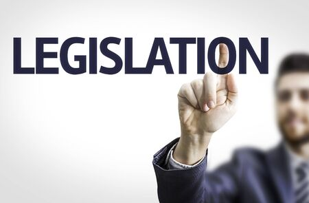 lawfulness: Business man pointing to transparent board with text: Legislation