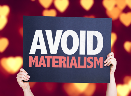 materialism: Avoid Materialism card with heart bokeh background Stock Photo