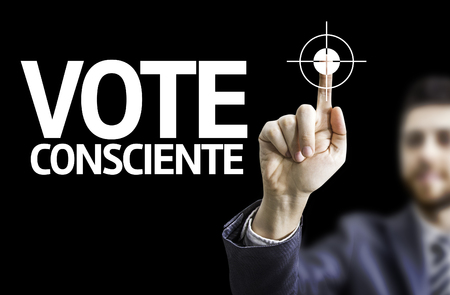 conscious: Business man pointing to black board with text: Conscious Vote (In Portuguese)