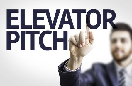 business pitch: Business man pointing to transparent board with text: Elevator Pitch
