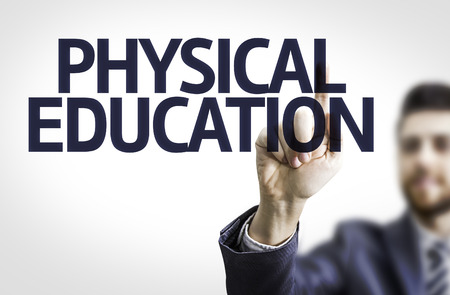 physical education: Business man pointing to transparent board with text: Physical Education Stock Photo