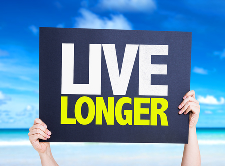 longer: Live Longer card with beach background