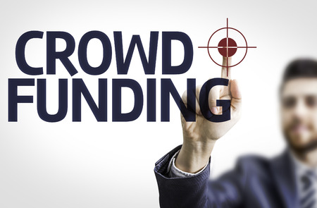 initiator: Business man pointing to transparent board with text: Crowdfunding Stock Photo