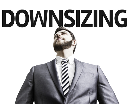 downsizing: Business man with the text Downsizing in a concept image