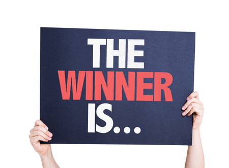 De winnaar is ... kaart op wit wordt geïsoleerd Stockfoto