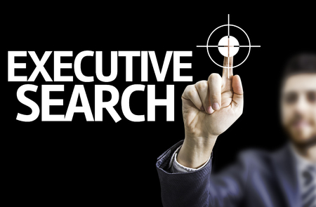 executive search: Business man pointing to black board with text: Executive Search Stock Photo
