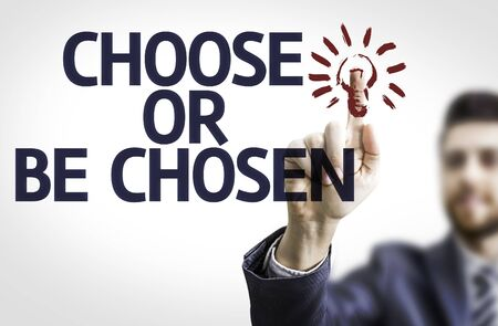 chosen: Business man pointing to transparent board with text: Choose or Be Chosen Stock Photo