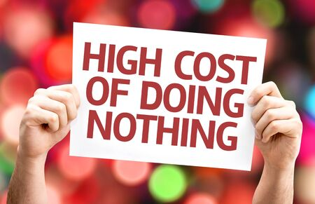high cost: High Cost of Doing Nothing card with colorful background with defocused lights Stock Photo