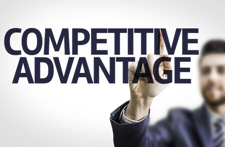 competitive advantage: Business man pointing to transparent board with text: Competitive Advantage