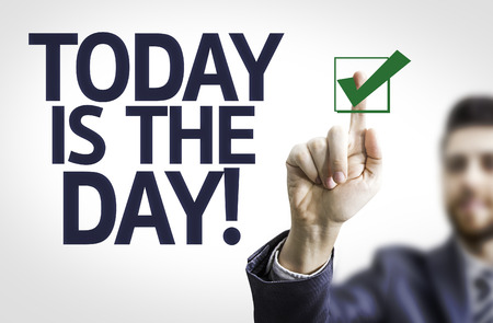 businesspersons: Business man pointing to transparent board with text: Today is The Day! Stock Photo