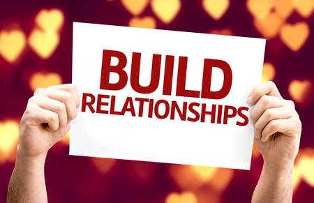 build: Build Relationships card with heart bokeh background Stock Photo