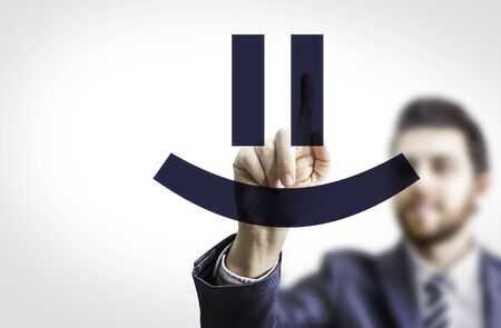 feeling happy: Business man pointing to transparent board one Smiley