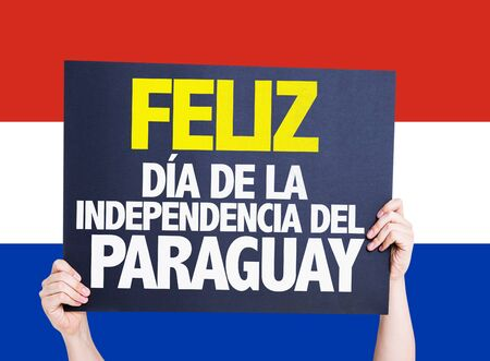 Hands holding Happy Paraguay Independence Day (in Spanish) card with paraguay flag