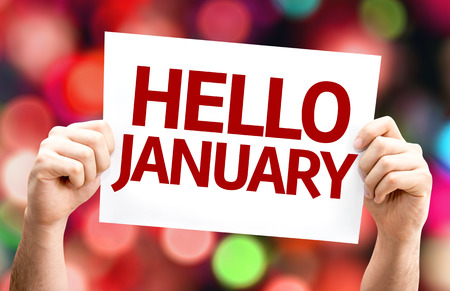 Hands holding Hello January card with bokeh background Stockfoto