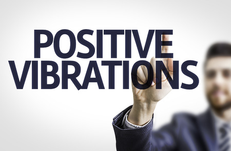 vibrations: Business man pointing to transparent board with text: Positive Vibrations