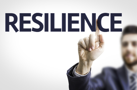 resilience: Business man pointing to transparent board with text: Resilience