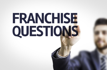 questions: Business man pointing to transparent board with text: Franchise Questions Stock Photo