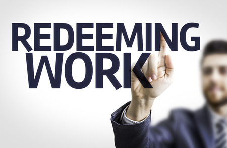 benevolence: Business man pointing to transparent board with text: Redeeming Work