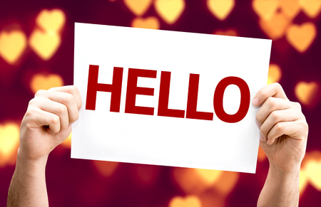 introduction: Hands holding Hello card with heart bokeh background Stock Photo